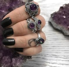 """ Be eccentric now. Don't wait for old age to wear purple""-Regina Brett . Amethyst and Mystic Topaz Sterling Silver rings  - - - #hellaholics #sterlingsilver #silverrings #silver #rings #crystal #crystals #stone #crystalstone #spiritual #witch #witchy #witchyjewelry #witchyfashion #occult #goth #gothic #gothstyle #boho #bohemian #vintagelook #amethyst #amethysts #amethystring #mystictopaz"