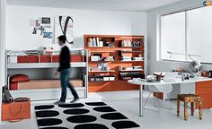 Trendy Teens Room In White Interior Nuance With Catchy Orange Touch With White Bunk Beds And Orange Beddings And Cool Black White Wall Shelves Mounted On Orange Wall Panel Also L Shaped Study Desk And Fur Rug