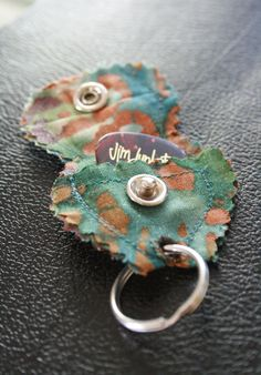 Guitar pick keychain. Would be great made out of leather.