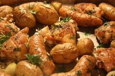 Roast Chicken Thighs with Sausage Potatoes and Garlic.