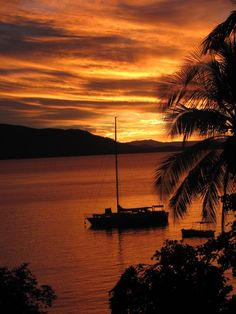 Sunset at Fitzroy Island North Queensland Australia with Yacht a great way to see the Great barrier reef