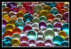 I still love playing with marbles, purees, steelies, boulders, pee wees, aggies, beach balls, cat's eyes... love them all.  : )