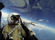 Selfie with Dreamliner: F-16 pilot takes self-portrait photo with Boeing 787 on his left wing.