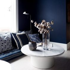moody lounge area with blue wall paint and floor cushion seating with round marble coffee tables Blue Painted Walls, Blue Walls, Ikea, Best Neutral Paint Colors, Hgtv Dream Homes, Melbourne House, Hacienda Style, White Rooms, Lounge Areas