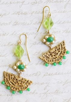 """Exotic Wonder Indie Dangle Earrings 32.99 at shopruche.com. Reminiscent of a vintage find, these indie designed drop earrings feature a golden pendant with green and white accents.  2"""" length"""