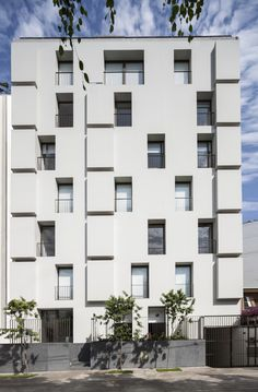 C-Q Project / JSª - a building with 7 apartments, with one apartment per level.