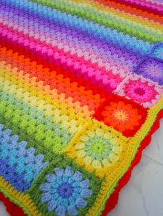 rainbow crocheted blanket. I love how it's strips of colors and then POOF a color explosion!