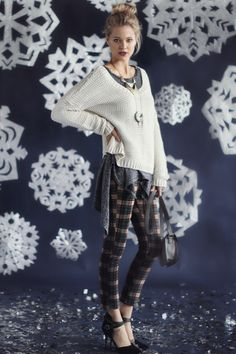 A cozy sweater and rad pair of plaid pants are winter essentials.