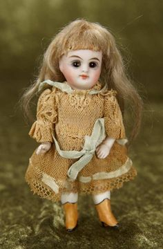 "4 1/2"" German all-bisque miniature with painted yellow boots by Kestner 200/400 