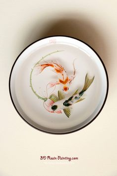 A couple of koi fish with lotus resin painting in a Chinese style teacup