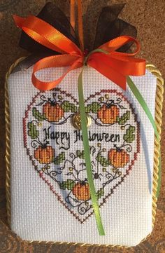 completed cross stitch Sweetheart Tree hearth Halloween ornament with pumpkins
