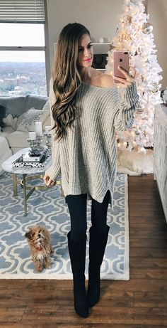 Oversized sweater, black leggings, black boots. and a cute puppy!!