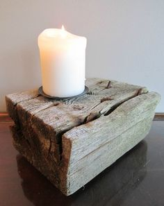 This driftwood candle holder would be perfectly at home at any lake or beach house, rustic wedding, or classy home.