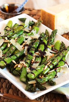 Roasted Asparagus with Pine Nuts Parmesan and Balsamic Glaze is ready in minutes. The perfect side dish for entertaining or a quick weeknight dinner!