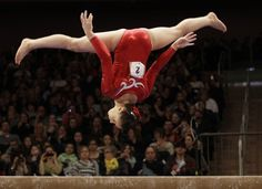 Canada's 15-year-old Victoria Moors flips on the balance beam during the American Cup gymnastics meet at Madison Square Garden in New York, Saturday, March 3, 2012.