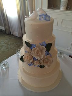 Simple dot wedding cake, Ivory, Blue hydrangeas, ivory roses, love bird topper