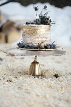 semi naked gold wedding cake topped with thistles