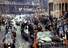 New York City welcomes Apollo 11 crewmen in a showering of ticker tape down Broadway and Park Avenue in a parade termed as the largest in the city's history. Pictured in the lead car, from the right, are astronauts Neil A. Armstrong, commander; Michael Collins, command module pilot; and Edwin E. Aldrin Jr., lunar module pilot. The three astronauts teamed for the first manned lunar landing, on July 20, 1969. Credit: NASA Photo by Bill Taub.
