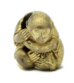 A gold ojime in the shape of a monkey By Juko/Toshimitsu, 19th century