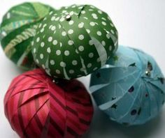 "Paper Lantern Ball Ornaments - paper strips (15 strips - ½""x4"" (7.5""x4"") or 3/4 - 5x8 1/4)) and brads- can be stored flat; 1/16 hole punch (do all at the same time or measure - misaligned holes a problem.  Tie hanger around top brad. Back of paper shows (concern if using recycled cards.)"