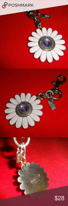 "COACH Lavender Enamel Daisy FLower Purse Charm COACH.... super cute statement charm to add to your handbag or iphone case! This daisy flower is made from silver metal with pale lavender enamel paint and a center purple stone. Attaches with a lobster clasp, and has a mini metal signature hang tag. Measures about 4"" long end to end (charm is around 2"") CONDITION:  Excellent condition. Coach Accessories"