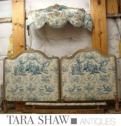 Blue toile upholstered antique french bed