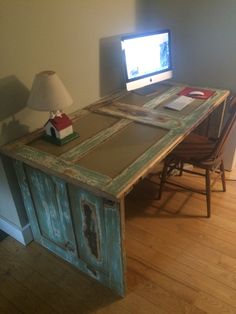 New computer desk made from reclaimed 6 panel doors. Sanded down to reveal layers of old paint, then covered with clear coat.