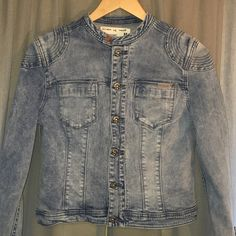 "Denim Jean Jacket Circle of Trust Denim Lolita Jacket size Medium. Shoulder width 16"", Armpit to Armpit 19"", Length 20"". Jacket features a Moto Style neck closure and detailed buttons as well as zippered Cuffs. Different from all the Rest. This jacket has never been buttoned until these pictures, so you know it's hardly been worn! Circle of Trust Jackets & Coats Jean Jackets"