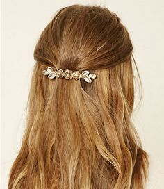Rosy outlook—Pearls and rhinestones embellish three small roses on this snap-closure barrette, ideal for the classic (and romantic) half and half hair style.  Rose barette, $5.