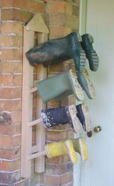 And if you like the peg approach but don't want the boots on the floor, there's this wall-mounted Wellington boot rack