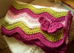 modern ripple baby blanket with butterfly. $38.00, via Etsy.