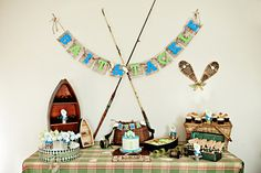 Evan's Vintage Fishing Themed 1st Birthday via Somewhere Splendid. Would be such a cute baby shower!