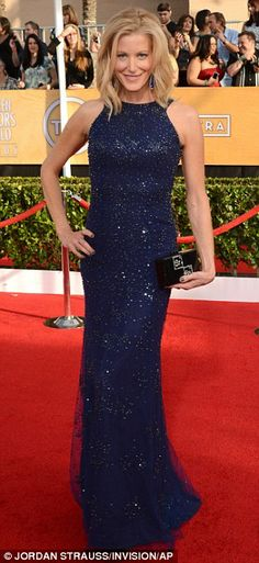 Anna Gunn in Monique Lhuillier and an Edie Parker clutch featuring the Breaking Bad logo at the SAG Awards