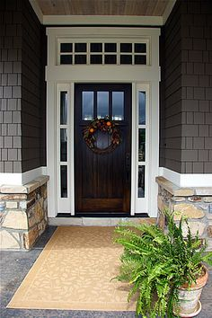 Lane Myers Construction Custom Home Builder Field of Dreams Entryway White Trim Gray Stone Exterior