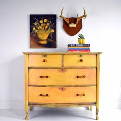 This peachy chest of drawers by Ildiko Horvath is painted with Chalk Paint® by Annie Sloan in Arles, a rich, glowing yellow and Scandinavian Pink, a traditional earthy Swedish-style pink. She has then used Black Chalk Paint® Wax to age the piece in a modern warehouse style.