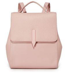 mini backpack by Karen Walker. A sophisticated Karen Walker backpack in a mix of smooth and pebbled leathers. Snaps gather the sides. The magnetic t...