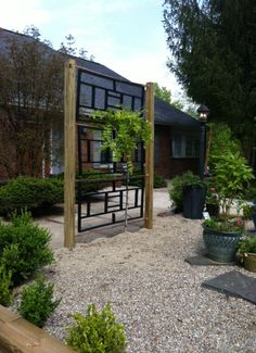 Our New Trellis- copper, pressure treated wood and much cursing. Voila! The wisteria has something to lean on.