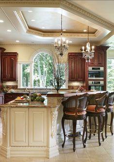 Beautiful kitchen. Love the mini chandeliers and warm tones.