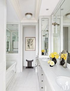 The master bath of Project Runway judge Nina Garcia's New York apartment features a ceiling light by Urban Archaeology; the sconces and tub are by Waterworks. The home was renovated and decorated by Carlos Aparicio of Aparicio + Assoc. Architectural Digest, Inspiration Design, Bathroom Inspiration, Design Ideas, Small Bathroom, Bathroom Spa, Bathroom Ideas, Bathroom Renovations, Bathroom Designs