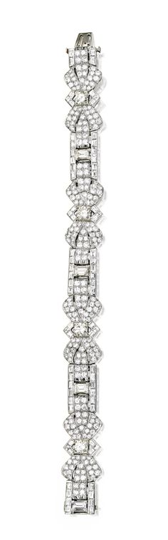 PLATINUM AND DIAMOND BRACELET.  Decorated with stylized bows, set with numerous round and baguette diamonds weighing approximately 12.80 carats, length 7 inches, with maker's marks.