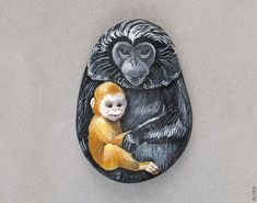 Painted rock. Monkey Mother and Monkey Baby