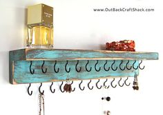 Distressed Wood shelf n hooks... I wonder how this would look for kitchen gadgets n pans