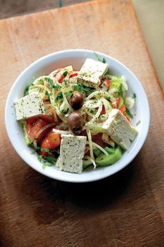 Horiatiki is the classic Greek village salad: cucumbers, super-fresh tomatoes, large cubes of feta, and oregano with lemon. A constant in our home with every dinner. Top with chicken or grilled shrimp to make a hearty meal out of it.