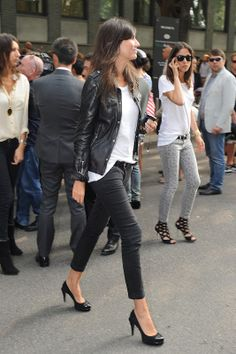 Black leather jacket - Emmanuelle Alt in her signature black ankle pants/jeans, tee and heels