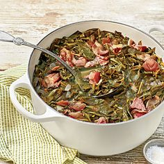 The Ultimate Classic Collards - 12 Ways To Cook with Greens - Southernliving. Recipe: The Ultimate Classic Collards Tangy vinegar brightens the earthy flavors, and a touch of honey rounds out the smoke from the ham hock. Vegetable Dishes, Vegetable Recipes, Bambi, Summer Casseroles, Turnip Greens, Summer Dishes, Summer Food, Feeding A Crowd, Southern Recipes