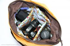Sew an insert to turn any large purse into a camera bag.  Hideous colors in the instructions, but very detailed!