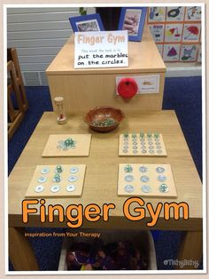 Finger Gym - marbles and washers. (Inspiration came from Your Therapy Source)