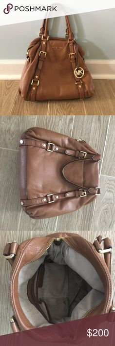 Michael Kors Purse Tan leather Micheal Kors purse and great condition.  Has some minor stains on the inside fabric and a little wear on the outside leather.  Comes with a removable long strap as well. Michael Kors Bags Totes