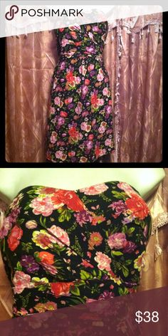Torrid Floral dress Reposh! I seriously love this dress. It's perfect for summer! It just didn't fit me well..I thought about taking it to a seamstress but I think someone else could really enjoy this dress! My loss is your gain torrid Dresses Midi