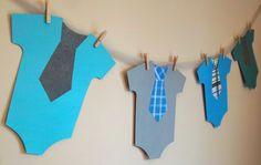 Erg leuke slinger voor op de babyborrel van je zoontje. Een waslijn met rompertjes.